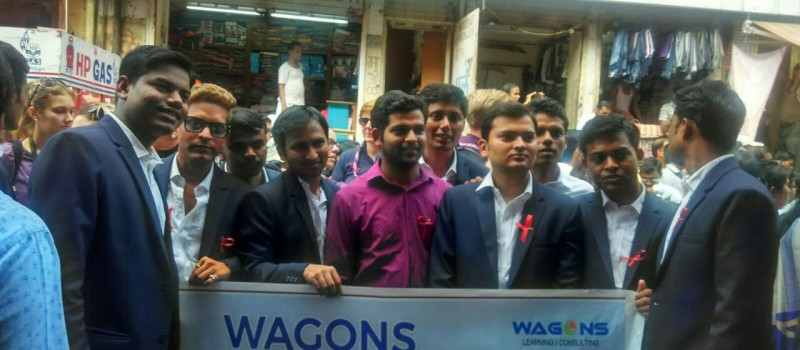 Members of Wagons Skill Foundation interact with society and discuss with them about the how to take care of HIV positive people