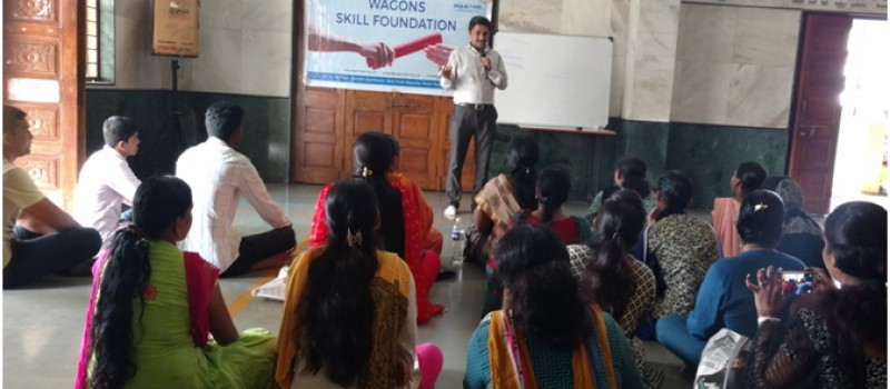 Trainer Delivering Seminar on Women Empowerment