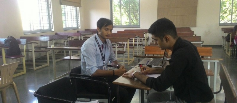 Mr. Rajkumar taking MCQ test during interview session.